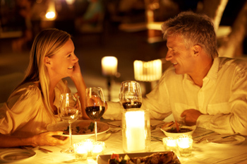 A young couple enjoying a romantic candlelight dinner at restaurant