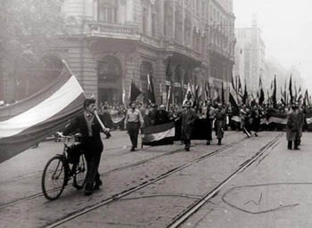 black and white photo of demonstrators on the streets of Budapest in 1956