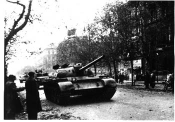 black and white photo of tanks on the street