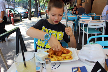our 8 year old son squeezing lemon juic eon his fish and chips