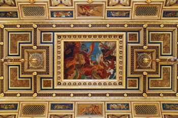 frescos in guilded frames on the ceiling of the hall