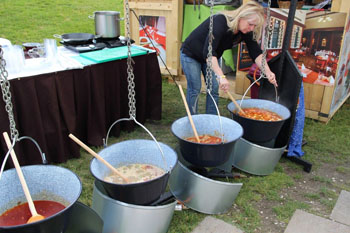 cooking goulash over open fire on the festival