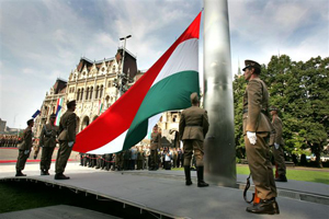 raising the Hungarian flag at the Parliament on a Public Holiday