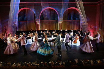 dancers and a music orchestra on stage in the Vigado's concert hall