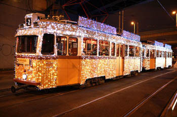 the yellow tram 2 in festive lighting at night