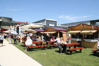 people sitting at wooden table on the Gourmet Festival in Millenaris park