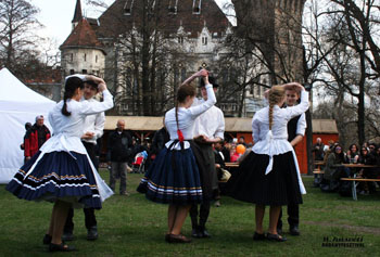 folk dancing in front of Vajdahunyad castle
