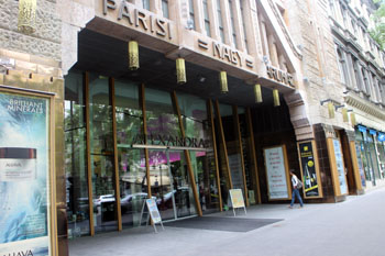 glass sliding entrance doors of and part of the facade of the Párisi Department store
