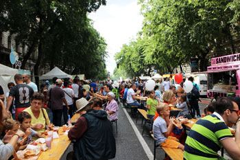 lots of people sitting at wooden tables on Andrassy on the Street Food show