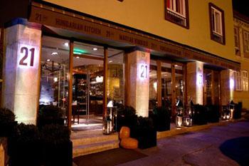 21 restaurant's entrance illuminated at night