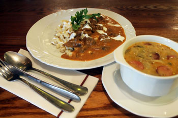 a ragout soup in a white bowl, veal paprikash with noodles on a white plate