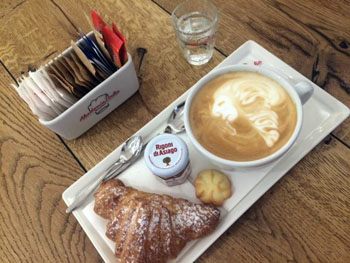 cappuccino with croissant in Akademia
