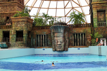 the wave pool with a Mayan guide statue in the backgroun, Aquaworld