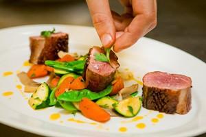 beefsteak and garnish on white plate