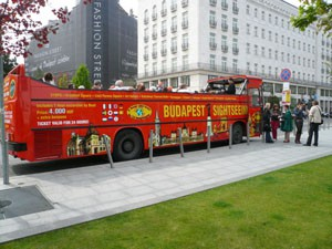 a red Sightseeing Bus