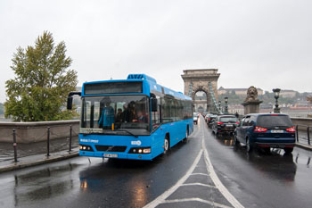 a blue Bus on the Chain Bridge Budapest