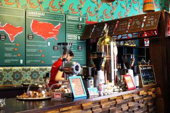 the counter and barista in Cafe Frei Váci utca