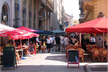 terraced restaurants with red tents on both sides of the Raday street