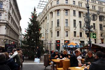 A Christmas tree on Vörösmarty ter , beginning of Vaci utca on a grey December afternoon