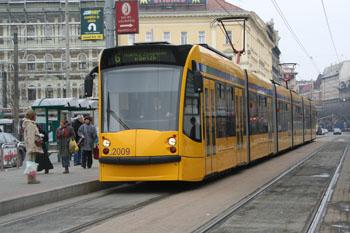 the yellow Combino Tram on Grand Boulevard