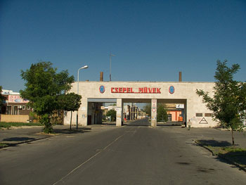 the entrance to the Csepel Industrial Compl. Csepel Művek written in red block letters