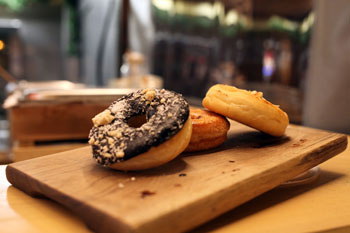 3 donuts, 1 with chocolate topping