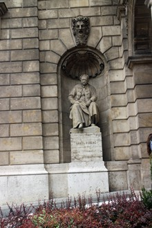 stone statue of Erkel sitting don