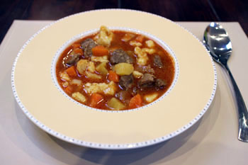 goulash soup in a beige soup bowl