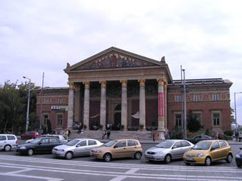 street view of the colonnaded hall, with a car park in front of it