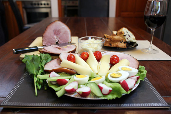 Hungarian Easter ham plate: ham slices, boiled egg, radish, lettuce