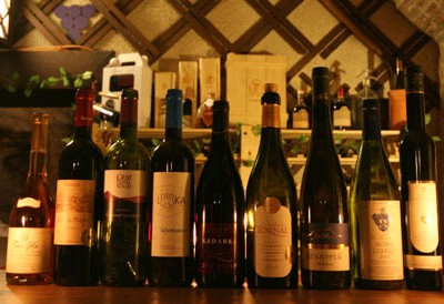 a dozen of wine bottles in a cellar