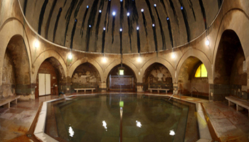 the Turkish-style vaulted interior of the Kiraly bath and the octagonal pool
