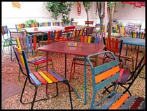 Colorful chairs in Kőleves's garden
