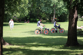 two bikers on the green lawn of Margaret Island