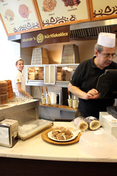 Mr. Molnar packing my Sekler cake behind the counter