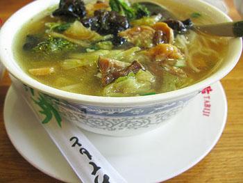 a bowl of chicken ramen in Momotaro