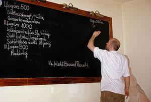 writing the menu on a black board Olimpia restaurant