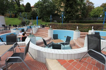 small garden tables and chairs in the empty children pools at Pagony