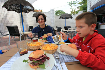 our family having burgers and fries in Pagony Restaurant