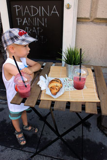 younger son having a strawberry smoothie at Piccolo cafe's terrace