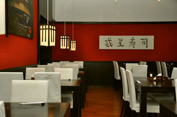 the red and black interior of Planet Sushi Oktogon