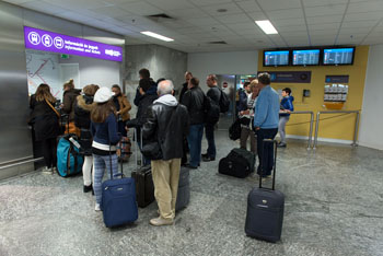 travellers queueing at the BKK customer point at the BP airport