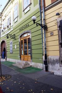 the green facade of the cake shop