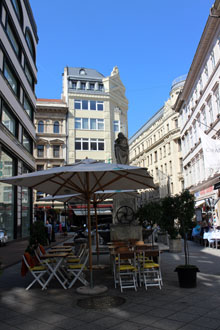 cafe terrace with shade and colorrful chairs