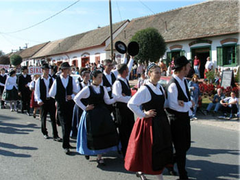 a festive harvest procession with people dressed in folk costume