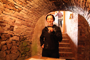 me sipping wine in a vualted stone cellar in Villany