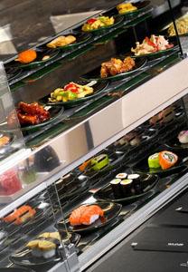 sushi on conveyor belt in Wasabi