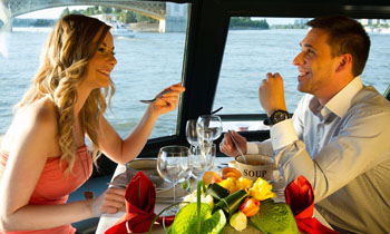 a young couple having lunch a Danube boat tour