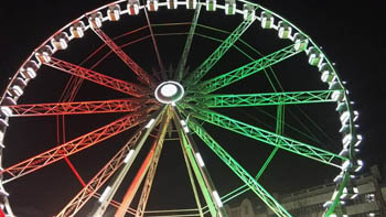 the ferris wheel illuminated in the national tricolor
