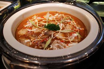 a bowl of catfish paprikash